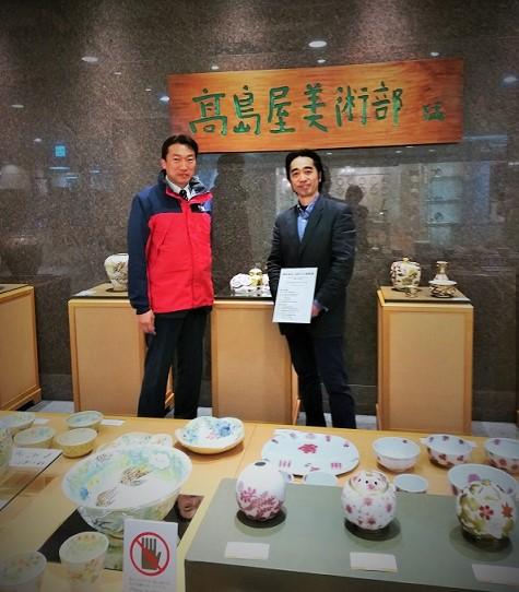 高島屋京都店での展示会にて京都市会議員の中野洋一と撮影した画像