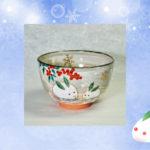 抹茶碗雪うさぎと南天のイメージ画像